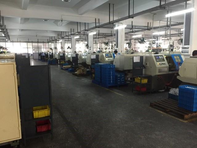 Rows of CNC lathes at a machine shop.