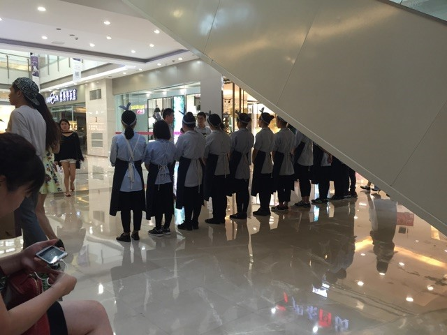 In a mall in Ningbo, the manager of a retail store had his employees stand at attention while he either trained them or dressed them down, in front of everyone. I felt bad for them and was tempted to walk behind him and put rabbit ears behind his head.